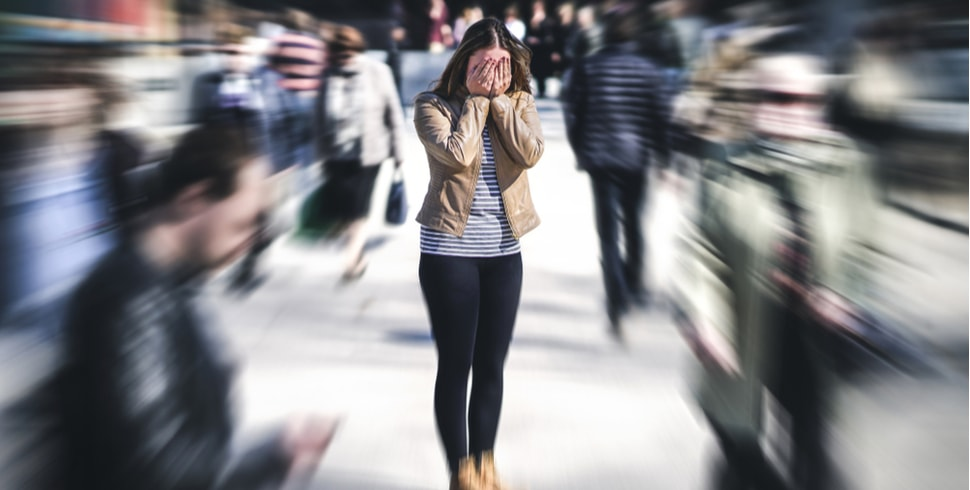 Woman Suffering from Anxiety in a crowd