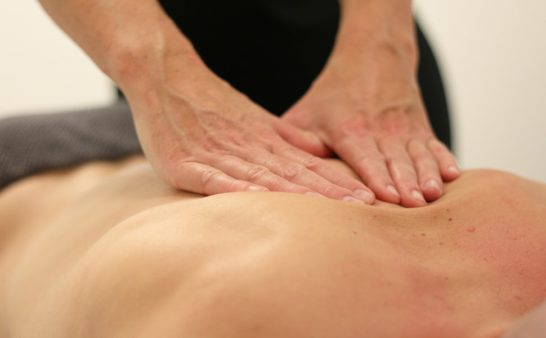 massage in the back with CBD